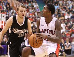 Kings' Nik Stauskas closes in on the Raptors' Lou Williams in Vancouver Sunday. (Carmine Marinelli/QMI Agency)