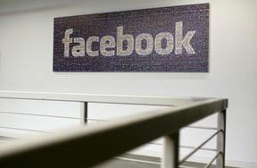 The Facebook logo is pictured in the Facebook headquarters in Menlo Park, California Jan. 29, 2013.  REUTERS/Robert Galbraith