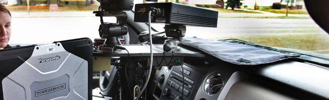 A peace officer operates a photo radar camera in Edmonton.