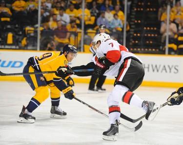 Oct 9, 2014; Nashville, TN, USA; Ottawa Senators center Kyle Turris (7) scores during the second period against the Nashville Predators at Bridgestone Arena. Mandatory Credit: Christopher Hanewinckel-USA TODAY Sports