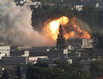 Smoke rises after an U.S.-led air strike in the Syrian town of Kobani October 10, 2014. REUTERS/Umit Bektas