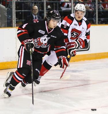 Ottawa 67's Ben Fanjoy pursues Niagara IceDogs Vince Dunn during OHL hockey action at TD Place on Friday October 10, 2014. Errol McGihon/Ottawa Sun/QMI Agency