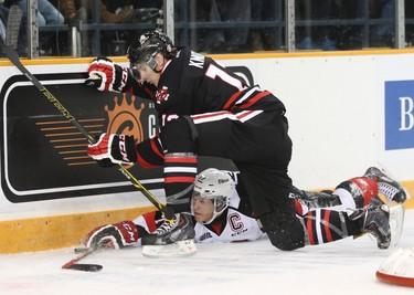 Ottawa 67's Travis Konecny gets upended Niagara IceDogs Graham Knott during OHL hockey action at TD Place on Friday October 10, 2014. Errol McGihon/Ottawa Sun/QMI Agency