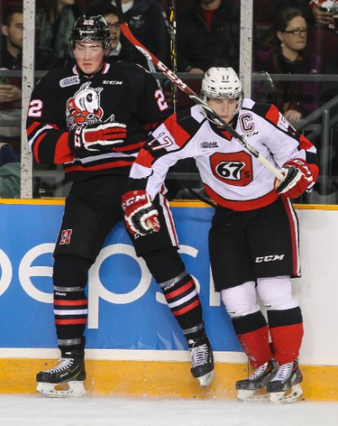 Ottawa 67's captain Travis Konecny nails Niagara IceDogs Ryan Mantha during OHL hockey action at TD Place on Friday October 10, 2014. Errol McGihon/Ottawa Sun/QMI Agency