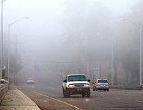 Vehicles drive through fog on the Quebec St. bridge in London on Thursday. DEREK RUTTAN/ The London Free Press /QMI AGENCY