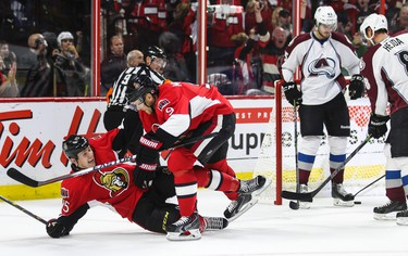 Ottawa Senators' Zack Smith (L) celebrates his goal with teammate Milan Michalek against the Colorado Avalanches' during NHL hockey action at the Canadian Tire Centre in Ottawa, Ontario on Thursday October 16, 2014. Errol McGihon/Ottawa Sun/QMI Agency