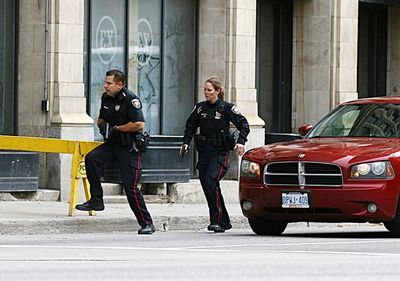 Police take up positions around Parliament Hill in Ottawa on Wednesday Oct. 22, 2014. Errol McGilhon/Ottawa Sun/QMI Agency