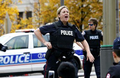 Police set up a perimeter near Parliament Hill in Ottawa on Wednesday Oct. 22, 2014. Errol McGilhon/Ottawa Sun/QMI Agency