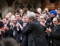 Harper and Trudeau hug