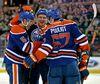 Oilers off-season veteran acquisitions Mark Fayne, Nikita Nikitin and Benoit Pouliot celebrate a Fayne pre-season goal in September at Rexall Place. (USA TODAY)