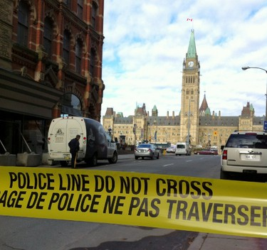 Police block off access to Parliament Hill after shots were fired on Wednesday Oct. 22, 2014 in Ottawa. Matt Usherwood/QMI Agency