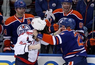 The Edmonton Oilers' Matt Hendricks (23) fights with Washington Capitals' Liam O'Brien (87) during first period NHL action at Rexall Place, in Edmonton Alta., on Wednesday Oct. 22, 2014. David Bloom/Edmonton Sun/QMI Agency