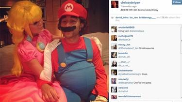 Chrissy Teigen and hubby John Legend do costume couples right at Princess Peach and Mario. (Instagram.com/chrissyteigen)  AHERE WE GO #nintendobirthdayA photo posted by @chrissyteigenon Nov 11, 2013 at 7:00pm PST