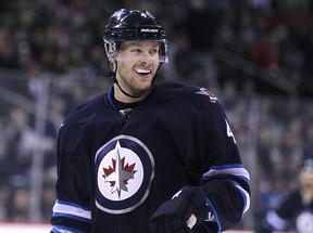 Jets defenceman Paul Postma wasn't smiling a year ago. (KEVIN KING/Winnipeg Sun files)