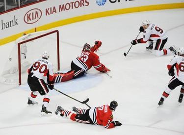 Oct 26, 2014; Chicago, IL, USA; Ottawa Senators left wing Milan Michalek (9) scores a goal on Chicago Blackhawks goalie Scott Darling (33) during the second period at the United Center. Mandatory Credit: David Banks-USA TODAY Sports