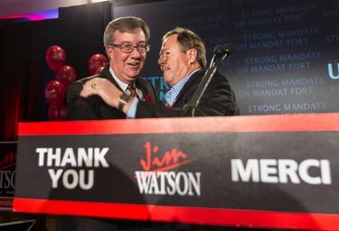 Jim Watson (L) is congratulated by former Ottawa mayor Jim Durrell after being elected again as Mayor of Ottawa. October 27, 2014. Errol McGihon/Ottawa Sun/QMI Agency