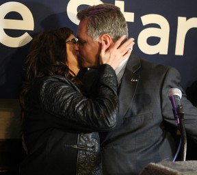 Mark Taylor celebrates his narrow victory with a big kiss for his wife Christine. DOUG HEMPSTEAD/Ottawa Sun