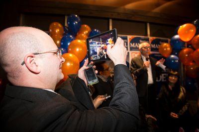 Fort McMurray-Conklin MLA Don Scott (left) takes a photo as Stephen Mandel celebrates winning the Edmonton-Whitemud riding at Hart's Table & Bar in Edmonton, Alta., on Monday, Oct. 27, 2014. Mandel, Alberta's Health Minister, ran for election in former Premier Dave Hancock's old seat. Ian Kucerak/Edmonton Sun/ QMI Agency
