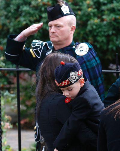 Son Marcus Cirillo with hat on. Funeral for CPL Cirillo  in Hamilton , Ont. on Tuesday October 28, 2014. Craig Robertson/Toronto Sun/QMI Agency