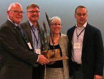 (L-r) Peter Pellatt (President of the ASVA) giving the award to Bob Gibbs PLWA Director, Susan Ellis PLWA President and Michael Gaian PLWA Director October 18. SUBMITTED