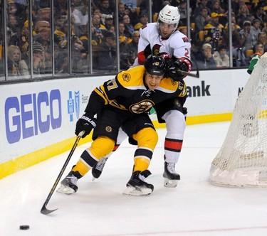 Nov 1, 2014; Boston, MA, USA; Boston Bruins left wing Milan Lucic (17) controls the puck past Ottawa Senators defenseman Jared Cowen (2) during the second period at TD Banknorth Garden. Mandatory Credit: Bob DeChiara-USA TODAY Sports