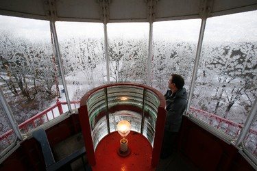 Warren Hoselton, parks supervisor of the Toronto Island and lighthouse, surveys the view from Gibraltar Lighthouse at Hanlan's Point. (Stan Behal/Toronto Sun)