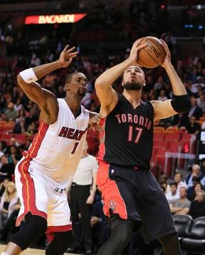 Heat forward Chris Bosh (left) defends against Raptors centre Jonas Valanciunas in Miami on Sunday. (USA TODAY Sports)