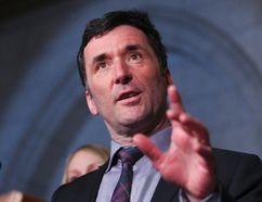 NDP MP Paul Dewar speaks to the media in Ottawa, March 26, 2013. (QMI Agency)