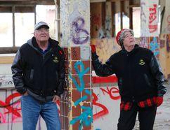 Author and historian Lynn Philip Hodgson and Marlene Hodgson at the remains of Camp 30. (MICHAEL PEAKE, Toronto Sun)