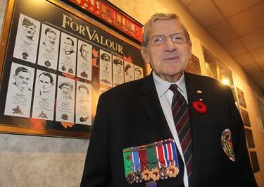 Veteran Sgt. Tom Munro stands next to a display of Victoria Cross winners at the Rockwood Legion in Winnipeg, Man. Thursday November 06, 2014. Brian Donogh/Winnipeg Sun/QMI Agency