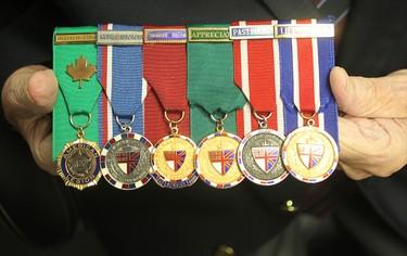 Veteran Sgt. Tom Munro displays his medals in Winnipeg, Man. Thursday November 06, 2014. Brian Donogh/Winnipeg Sun/QMI Agency