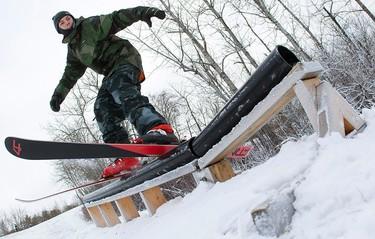 Wyatt Klimczak, 16, rides a rail while skiing at the Edmonton Ski Club, 9613 96 Ave., in Edmonton Alta., on Tuesday Nov. 11, 2014. David Bloom/Edmonton Sun/QMI Agency
