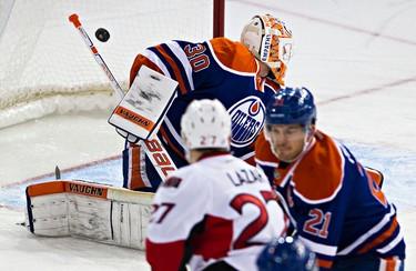 Edmonton's goalie Ben Scrivens (30) can't stop Ottawa's Mike Hoffman (68), not pictured, from scoring during the Edmonton Oilers' NHL hockey game against the Ottawa Senators at Rexall Place in Edmonton, Alta., on Thursday, Nov. 13, 2014. Codie McLachlan/Edmonton Sun/QMI Agency