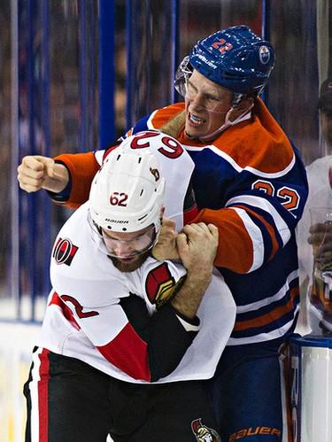 Edmonton's Keith Aulie (22) fights Ottawa's Eric Gryba (62) during the Edmonton Oilers' NHL hockey game against the Ottawa Senators at Rexall Place in Edmonton, Alta., on Thursday, Nov. 13, 2014. Codie McLachlan/Edmonton Sun/QMI Agency