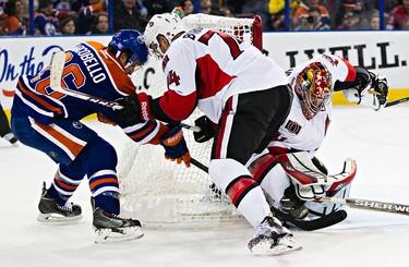 Edmonton's Mark Arcobello (26) can't get past Ottawa's goalie Craig Anderson (41) during the Edmonton Oilers' NHL hockey game against the Ottawa Senators at Rexall Place in Edmonton, Alta., on Thursday, Nov. 13, 2014. Codie McLachlan/Edmonton Sun/QMI Agency
