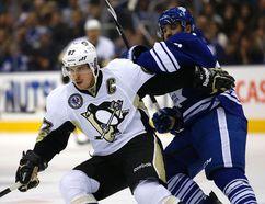 Maple Leafs' Nazem Kadri battles Sidney Crosby of the Pittsburgh Penguins on Nov. 14, 2014. (Craig Robertson, Toronto Sun)