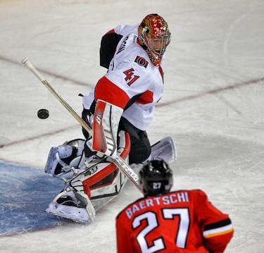Ottawa Senators Craig Anderson makes a save against the Calgary Flames during NHL hockey in Calgary, Alta. on Saturday November 15, 2014. Al Charest/Calgary Sun/QMI Agency