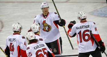 Ottawa Senators Clarke Macarthur celebrates his goal with teammates against the Calgary Flames during NHL hockey in Calgary, Alta. on Saturday November 15, 2014. Al Charest/Calgary Sun/QMI Agency