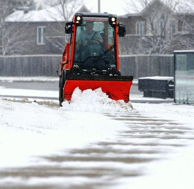 A sidewalk snowplow clears snow in Ottawa, Ont., on November 17, 2014. (Errol McGihon/QMI Agency)