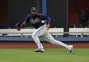 Atlanta Braves right fielder Jason Heyward (22) fields a ball hit by New York Mets first baseman Lucas Duda during the first inning at Citi Field.  (Adam Hunger/USA TODAY Sports)