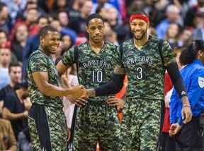 Raptors forward James Johnson (right) sprained his ankle against the Utah Jazz on Saturday. (TORONTO SUN)