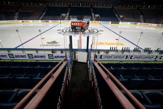 A Zamboni crew cleans the ice before an Edmonton Oilers  practice held at Rexall Place in Edmonton, Alta., on Nov. 14, 2013. (Ian Kucerak/Edmonton Sun/QMI Agency)