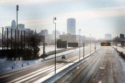 A single car drives along Route 190 in Buffalo, New York, November 19, 2014.   REUTERS/Lindsay DeDario