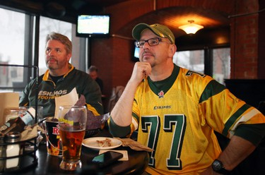Edmonton Eskimos fans Gary Mayorchak, 53, right, and Mike Talty, 52, watch the CFL West Final at The Pint, 10125-109 St., in downtown Edmonton on Sunday, November 23, 2014. TREVOR ROBB/EDMONTON SUN/QMI AGENCY