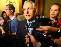 Energy Minister Bob Chiarelli speaks to media at Queen's Park in Toronto. (Dave Abel/Toronto Sun)