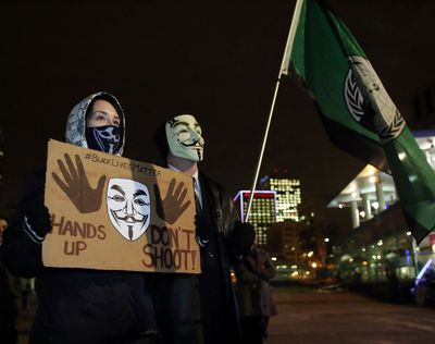Protestors gather at Winston Churchill Square in downtown Edmonton on Tuesday, November 25, 2014 speaking out against the killing of Ferguson, Mo teenager, Michael Brown. TREVOR ROBB/EDMONTON SUN/QMI AGENCY