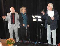 Mo Bock, Diane Stapley listen as Cliff Edwards performs a song from Oklahoma!