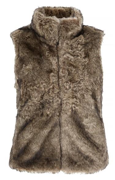 For the accessorizer.Faux-Fur Vest, $160.00; Banana Republic