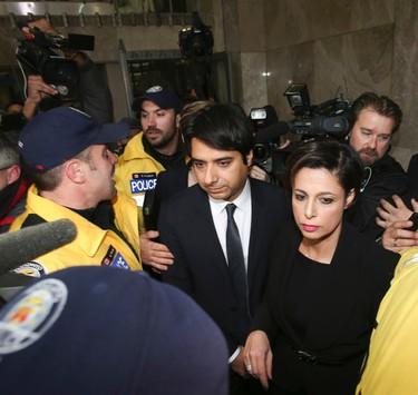 Jian Ghomeshi leaves College Park Courts  on Wednesday, Nov. 26, 2014. Veronica Henri/Toronto Sun/QMI Agency