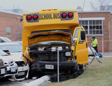 Mini-school bus crash on Sinnot Rd., just south of Eglinton Ave. E., around 2 p.m. Tuesday, Dec. 3, 2014. (Ernest Doroszuk/Toronto Sun)